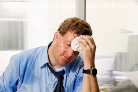 man-sweating-at-desk-free